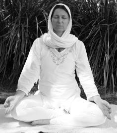 Siri Shakti Kaur in Kundalini yoga meditation pose